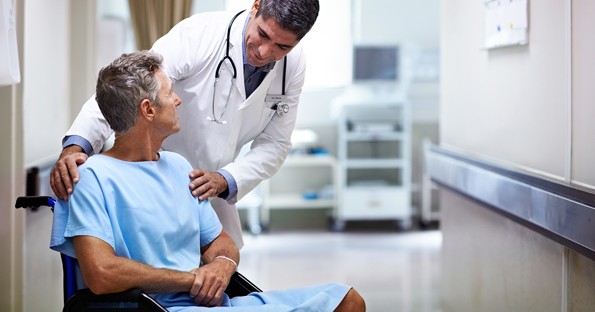patient in wheelchair talking to doctor