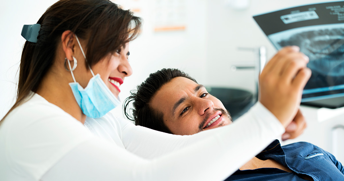 dentist and patient reviewing x-ray