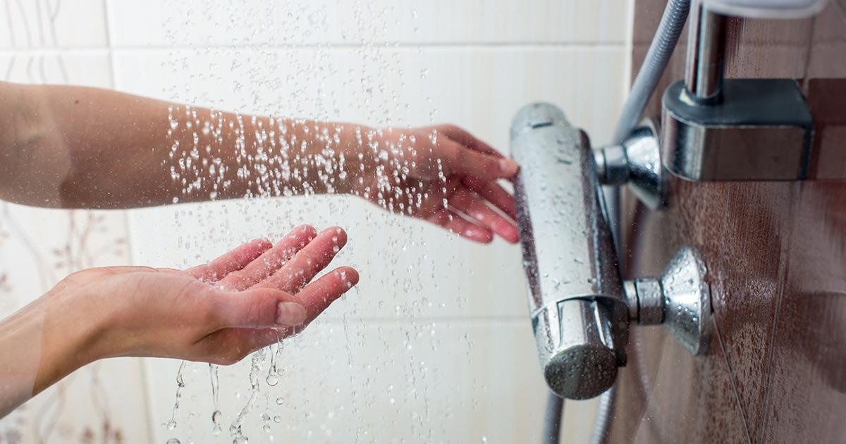 person turning shower knob