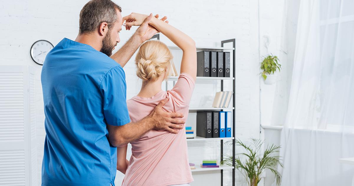 chiropractor adjusting a patients spine