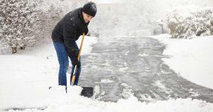 Man shoveling snow off driveway
