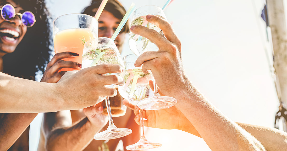group of friends clinking alcoholic beverages