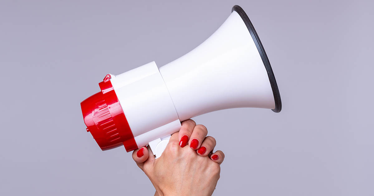 Woman holding up a megaphone