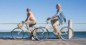 A couple is biking outside