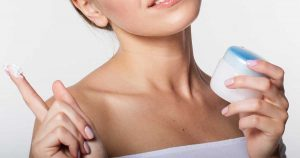 a woman holding psoriasis cream